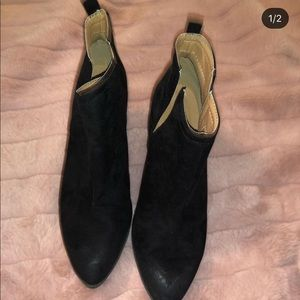 Size 6 1/2 Black booties. Never worn